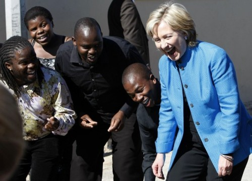 United States Secretary of State Hillary Clinton  greets well wishers during a visit to the Victoria Mxenge housing project near Cape Town