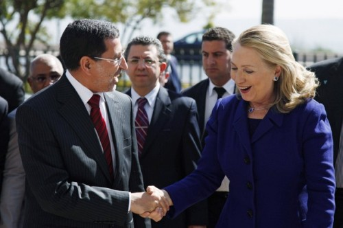 U.S. Secretary of State Hillary Clinton shakes hands with Morocco's Foreign Minister Saad Eddine Othmani in Rabat