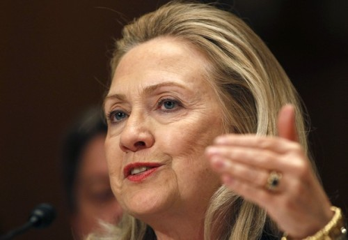 U.S. Secretary of State Hillary Clinton gestures while testifying on Capitol Hill in Washington