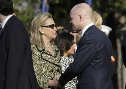 British Foreign Secretary William Hague (R) greets U.S. Secretary of State Hillary Clinton before an Official Arrival Ceremony for British Prime Minister David Cameron on the South Lawn of the White House in Washington