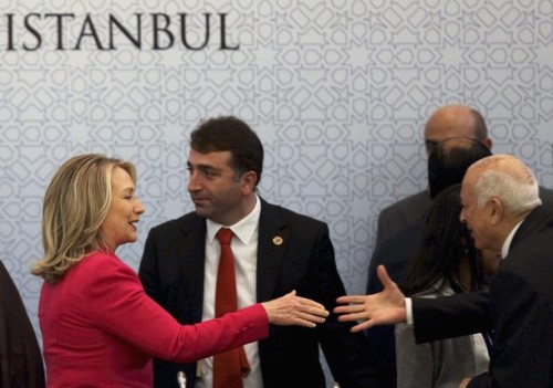 """U.S. Secretary of State Clinton is welcomed by Arab League Secretary-General Elaraby during """"Friends of Syria"""" conference in Istanbul"""