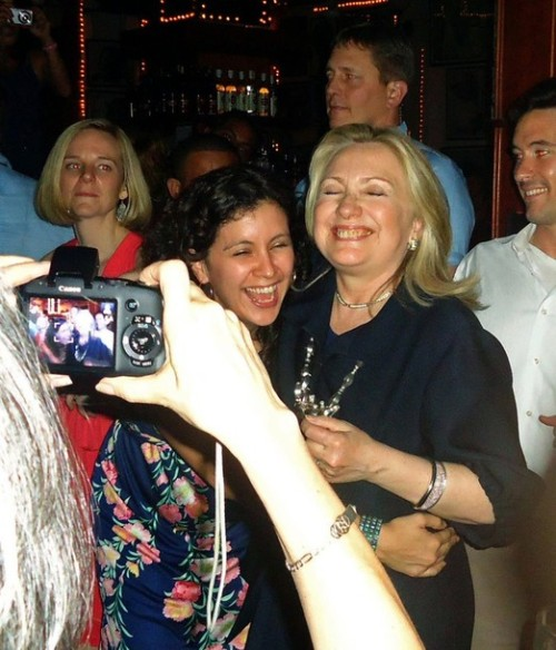 U.S. Secretary of State Hillary Clinton dances with members of her delegation in the Cafe Havana salsa bar, during a break from the Americas Summit in Cartagena