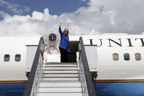U.S. Secretary of State Hillary Clinton, en route to Brussels, waves goodbye in Brasilia