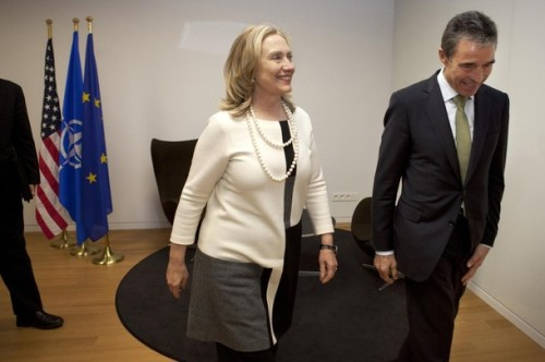 U.S. Secretary of State Hillary Clinton walks with NATO Secretary General Anders Fogh Rasmussen for a meeting at the NATO headquarters in Brussels