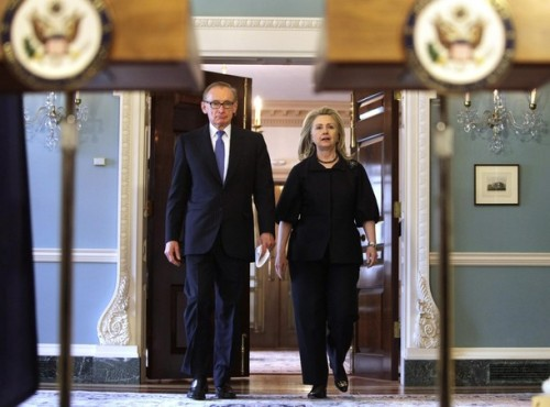 U.S. Secretary of State Hillary Clinton walks with Australian Foreign Minister Bob Carr after their meeting at the State Department in Washington