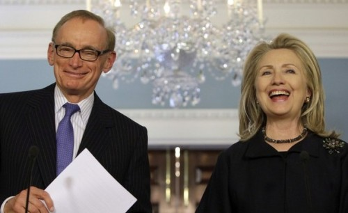 U.S. Secretary of State Hillary Clinton laughs with Australian Foreign Minister Bob Carr after their meeting at the State Department in Washington