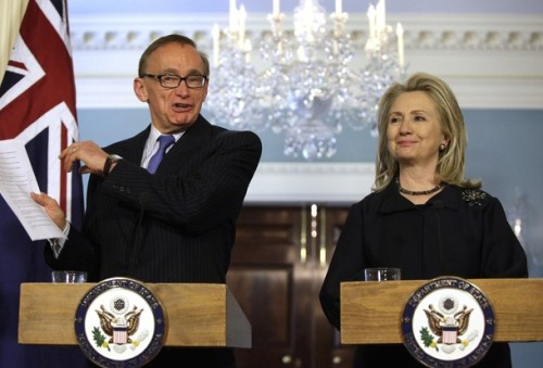 Australian Foreign Minister Bob Carr talks to the media next to U.S. Secretary of State Hillary Clinton after their meeting at the State Department in Washington