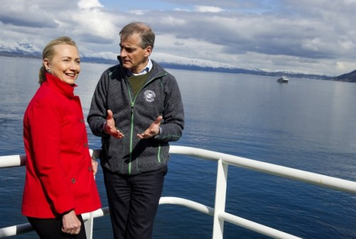 US Secretary of State Hillary Clinton and Norway's Minister of Foreign Affairs Jonas Gahr Stoere (R), talk onboard the Arctic Research Vessel Helmer Hanssen during a boat tour of a fjord off of Troms rway, in the Arctic Circle, June 2, 2012. AFP PHOTO / POOL / Saul LOEB        (Photo credit should read SAUL LOEB/AFP/GettyImages)