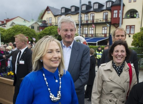 US Secretary of State Hillary Clinton (L), Swedish Defense Minister Karin Enstrom (R) and Swedish Foreign Minister Carl Bildt (C) walk back to their boat after greeting locals at Vaxholm Island near Stockholm on June 3, 2012. Clinton and Bildt took a boat from nearby Stockholm to the island to pick up Enstrom for a meeting on the boat trip back to the city. AFP PHOTO / POOL / Saul LOEB        (Photo credit should read SAUL LOEB/AFP/GettyImages)