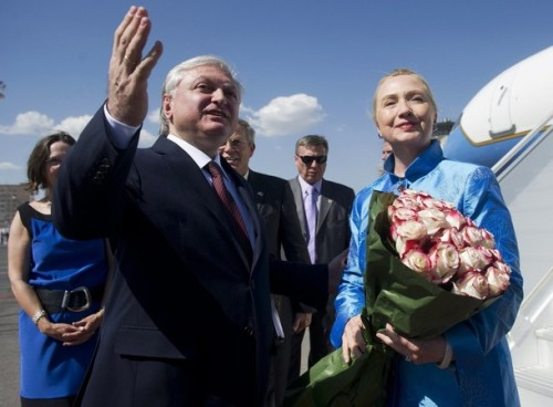 Armenia's Foreign Minister Edward Nalbandian (L) greets U.S. Secretary of State Hillary Clinton after her arrival at Yerevan International Airport in Yerevan June 4, 2012. REUTERS/Saul Loeb/Pool (ARMENIA - Tags: POLITICS)