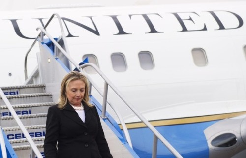 """US Secretary of State Hillary Clinton gets off her plane as she arrives at Ataturk Airport in Istanbul on June 6, 2012. US Secretary of State Hillary Clinton will meet her British, French, Turkish and some Arab counterparts on June 7 to """"discuss the situation in Syria,"""" a Turkish diplomatic source said. AFP PHOTO / POOL / Saul LOEB        (Photo credit should read SAUL LOEB/AFP/GettyImages)"""