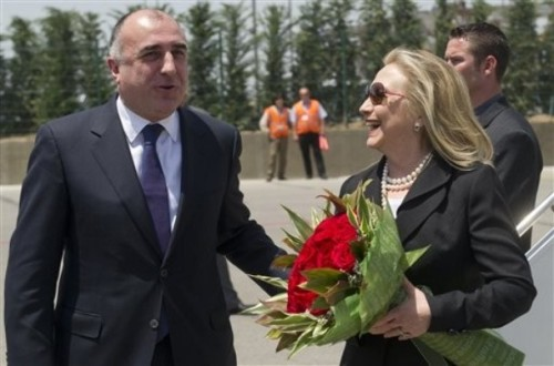 Azeri Foreign Minister Elmar Mammadyarov, left, greets US Secretary of State Hillary Rodham Clinton Wednesday June 6, 2012 upon her arrival the Heydar Aliyev International Airport in Baku, Azerbaijan.  Clinton has embarked on a tour of the South Caucasus in the hope of mediating progress in territorial disputes in the region.       (AP Photo/Saul Loeb, Pool)