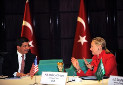 US Secretary of State Hillary Clinton(R) speaks with Turkish Foreign Minister Ahmet Davutoglu before their meeting on discuss the situation in Syria, a Turkish diplomatic source said, on June 6, 2012, in Istanbul. AFP PHOTO/BULENT KILIC        (Photo credit should read BULENT KILIC/AFP/GettyImages)