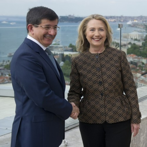 Turkish Foreign Minister Ahmet Davutoglu shakes hands with US Secretary of State Hillary Clinton before taking part in meetings in Istanbul on June 7, 2012.  AFP PHOTO / POOL / Saul LOEB        (Photo credit should read SAUL LOEB/AFP/GettyImages)