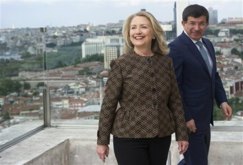 Turkish Foreign Minister Ahmet Davutoglu, left, and U.S. Secretary of State Hillary Rodham Clinton arrive for a meeting in Istanbul Thursday, June 7, 2012. (AP Photo/Saul Loeb, Pool)