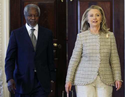 United States Secretary of State Hillary Clinton and Arab League Joint Special Envoy for Syria Kofi Annan walk to the podium  in Washington