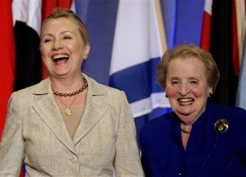 Secretary of State Hillary Rodham Clinton, left, and former Secretary of State Madeleine Albright respond to applause as Clinton is introduced to a gathering of the Women in Public Service Institute at Wellesley College in Wellesley, Mass., Monday, June 11, 2012. Both women are graduates of Wellesely. (AP Photo/Stephan Savoia)