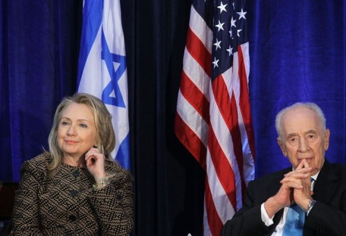WASHINGTON, DC - JUNE 12:  U.S. Secretary of State Hillary Clinton (L) and Israeli President Shimon Peres (R) participate in a discussion at the Hay Adams Hotel June 12, 2012 in Washington, DC. The Clinton-Peres discussion was part of the 10th anniversary celebration of the Saban Center for Middle East Policy of Brookings Institution.  (Photo by Alex Wong/Getty Images)