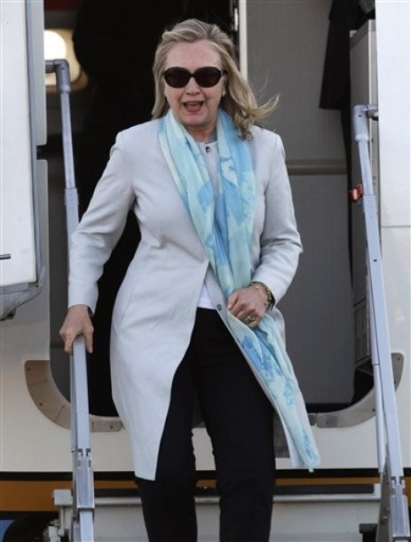 U.S. Secretary of State Hillary Clinton arrives to Los Cabos international airport to attend the G-20 Summit in Baja California Sur, Mexico, Sunday, June 17, 2012. (AP Photo/Eduardo Verdugo)