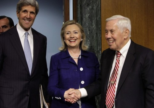 U.S. Secretary of State Hillary Clinton (C) shakes hands with Sen. Richard Lugar (R-IN) as Sen. John Kerry (D-MA) smiles, as she arrives to testify before the Senate Foreign Relations Committee hearing on Evaluating Goals and Progress in Afghanistan and Pakistan on Capitol Hill in Washington June 23, 2011. REUTERS/Yuri Gripas (UNITED STATES - Tags: POLITICS)
