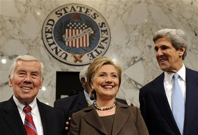 Secretary of State-designate Sen. Hillary Rodham Clinton, D-N.Y., center, stands with Senate Foreign Relations Committee Chairman Sen. John Kerry, D-Mass., right, and the committee's ranking Republican Sen. Richard Lugar, R-Ind., on Capitol Hill in Washington, Tuesday, Jan. 13, 2009, before the start of her nomination hearing before the committee. (AP Photo/Susan Walsh)