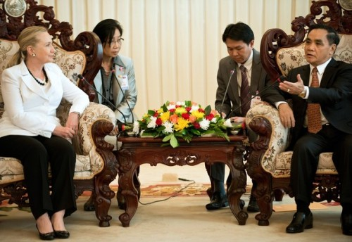 US Secretary of State Hillary Clinton (L) listens to Laotian Prime Minister Thongsing Thammavong (R) at their meeting at the prime minister's office in Vientiane on July 11, 2012. Clinton became the first US secretary of state to visit Laos for 57 years, on a trip focused on the damaging legacy of the Vietnam War and a controversial dam project. AFP PHOTO / POOL / Brendan SMIALOWSKI              (Photo credit should read BRENDAN SMIALOWSKI/AFP/GettyImages)