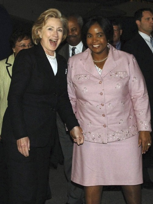 """U.S. Secretary of State Hillary Clinton (L) smiles as she is welcomed by South Africa's Minister of International Relations Maite Nkoana-Mashabane at the O.R. Tambo airport in Johannesburg August 6, 2009 on her second stop in an 11-day trip to Africa. Clinton said Thursday she would press South Africa to use more of its influence to counter the """"negative effects"""" of Zimbabwe's President Robert Mugabe. REUTERS/Jacoline Prinsloo/ GCIS/Handout (SOUTH AFRICA POLITICS)"""