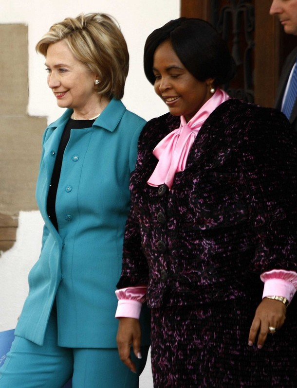 U.S. Secretary of State Hillary Clinton (l) leaves after her meeting with  International Relations  minister, Maite Nkoana-Mashabane in Pretoria