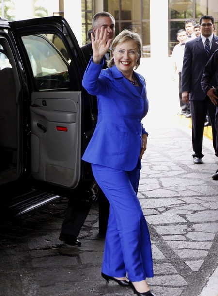 U.S. Secretary of State Hillary Clinton waves as she arrives at a hotel to attend a conference in San Salvador