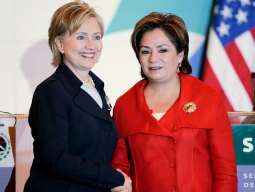 US Secretary of State Clinton shakes hands with Mexican Foreign Secretary Espinosa after a news conference in Mexico City
