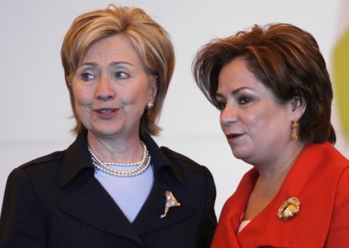 US Secretary of State Clinton talks with Mexican Foreign Minister Espinosa after a news conference in Mexico City
