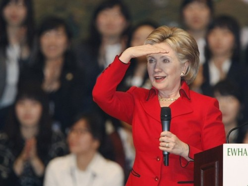 U.S. Secretary of State Hillary Clinton looks at a student asking her a question, after speech at Ewha Womans University in Seoul