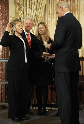Clinton is joined by her husband and daughter as she is ceremonially sworn in by Biden at the State Department in Washington
