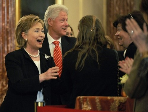 Clinton and her husband greet people as they arrive for her ceremonial swearing-in at the State Department in Washington