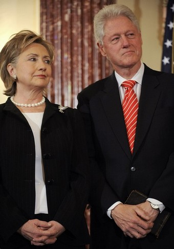 Clinton and her husband arrive for her ceremonial swearing-in at the State Department in Washington