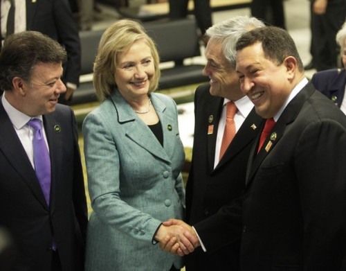 U.S. Secretary of State Hillary Clinton speaks with presidents Santos, Chavez and Pinera in Brasilia