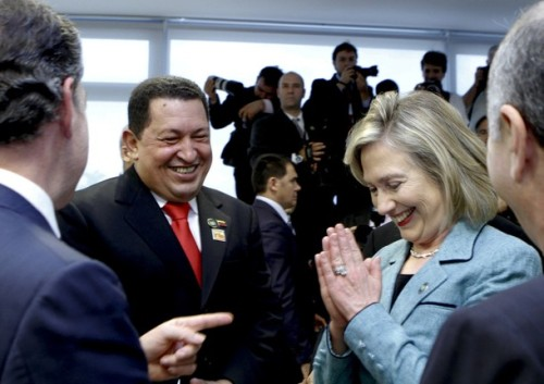 U.S. Secretary of State Clinton gestures as Colombia's President Santos points to Clinton and Venezuela's President Chavez laughs during a reception in Brasilia