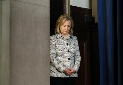 Clinton waits to walk onto stage at US-China Strategic and Economic Dialogue in Washington