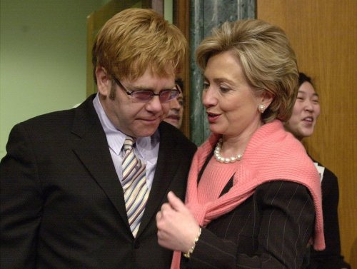 clinton-has-some-very-famous-friends-here-she-is-greeting-elton-john-in-2002-before-his-senate-testimony-on-the-aids-epidemic