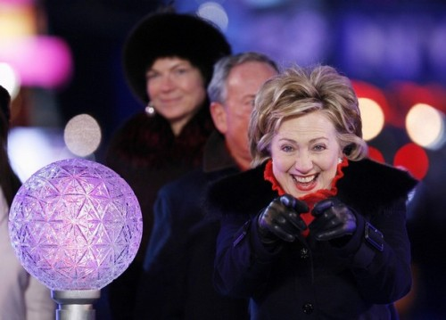 U.S. Senator Clinton reacts to the crowd in Times Square before pushing the button to lower the crystal ball during New Year festivities in New York