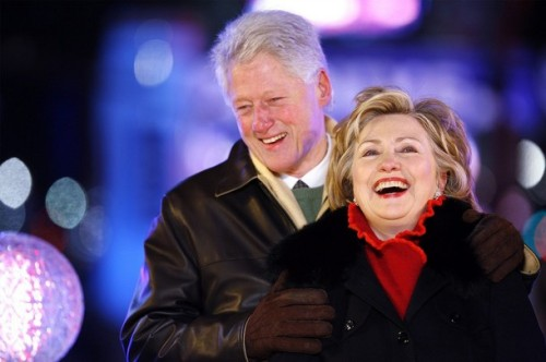 Bill and Hillary Clinton celebrate at midnight in Times Square after pushing the button to lower the crystal ball during New Year festivities in New York