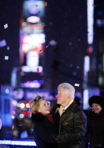 Former US President Clinton and his wife US Senator Hillary dance at midnight in Times Square during New Year festivities in New York