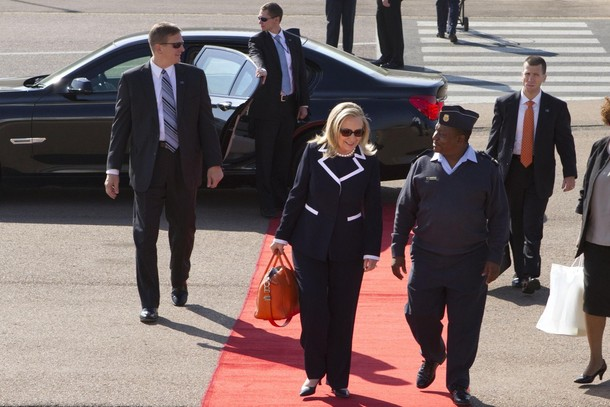 U.S. Secretary of State Hillary Clinton boards a plane to Qunu, for a private meeting with former South African President Nelson Mandela, at Waterkloof Air Base in Johannesburg