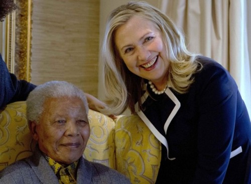 U.S. Secretary of State Hillary Rodham Clinton poses for a photograph with Nelson Mandela, former president of South Africa, at his home in Qunu