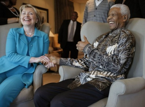 U.S. Secretary of State Hillary Clinton smiles at the Nelson Mandela foundation in Johannesburg