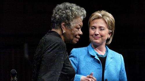 In this April 18, 2008 photo, then U.S. Sen. Hillary Clinton holds hands with Maya Angelou as they are applauded following a program at Wait Chapel on the campus of Wake Forest University in Winston-Salem, N.C. Angelou, a Renaissance woman and cultural pioneer, has died, Wake Forest University said in a statement Wednesday, May 28, 2014. She was 86. (AP Photo/Winston-Salem Journal, Lauren Carroll)