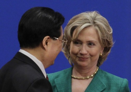 U.S. Secretary of State Hillary Clinton looks at China's President Hu Jintao during the opening ceremony of the China-U.S. Strategic and Economic Dialogue in Beijing