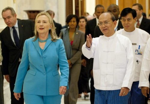 U.S. Secretary of State Hillary Clinton walks with Myanmar's President Thein Sein in between meetings at the President's Office in Naypyitaw