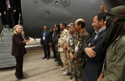 U.S. Secretary of State Clinton meets soldiers at the steps of her C-17 military transport upon her arrival in Tripoli