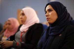 Libyan students listen to U.S. Secretary of State Hillary Clinton speak during a town hall meeting with the Youth and Civil Society at Tripoli University